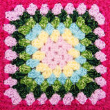 Multicolored plaid square of crocheted Stock Photos