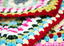 Multicolored plaid square of crocheted Royalty Free Stock Photography