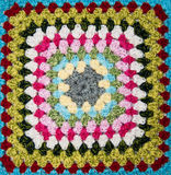 Multicolored plaid square of crocheted Royalty Free Stock Images