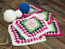 Multicolored plaid squares of crocheted Royalty Free Stock Photos