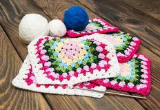 Multicolored plaid squares of crocheted Stock Images