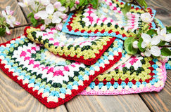 Multicolored plaid squares of crocheted Stock Photography