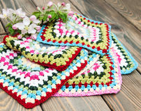Multicolored plaid squares of crocheted Stock Photos