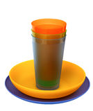 Multicolored plastic plates, cups Stock Image