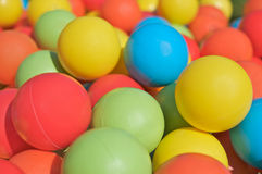 Multicolored plastic balls. In a playground for kids Royalty Free Stock Photos