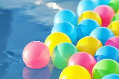 Multicolored plastic balls float in the children`s pool Royalty Free Stock Photography