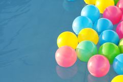 Multicolored plastic balls float in the children`s pool Royalty Free Stock Photos