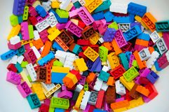 Lego constructor, plastic building blocks. Multicolored plastic building blocks of the designer. Background of bright plastic building blocks stock photography