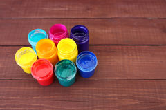 Multicolored plastic cans with paints. Artist workplace background. Art tools. Paints background. Colorful artist palette. Soft to Royalty Free Stock Photo