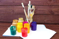 Multicolored plastic cans with paints. Artist workplace background. Art tools. Paints background. Colorful artist palette. Soft to Stock Photography