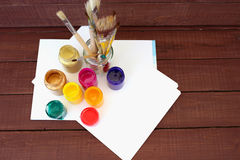 Multicolored plastic cans with paints. Artist workplace background. Art tools. Paints background. Colorful artist palette. Soft to Stock Photo
