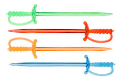 Multicolored plastic food skewers in rapier shape Royalty Free Stock Image