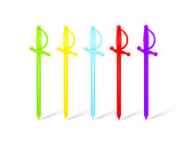 Multicolored plastic food skewers in rapier shape. On white Royalty Free Stock Photo