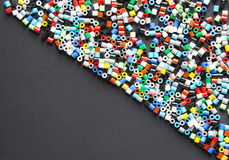 Multicolored plastic pearls/beads. Colorful plastic hama beads for kids. With Copy-space Royalty Free Stock Photography