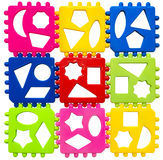 Multicolored plastic puzzle. S on a white background. View from above. Early development of children. The study of geometric shapes Stock Image
