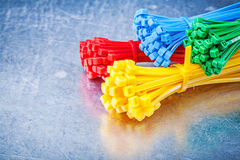Multicolored plastic tying cables on metallic background constru Royalty Free Stock Photography