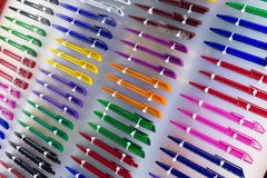 Multicolored plastic writing pens. On the counter stock photos