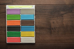 Multicolored plasticine bars on the table Royalty Free Stock Image