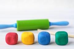 Multicolored plasticine modeling tools. Stock Image