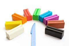 Multicolored plasticine with plastic knife Royalty Free Stock Photos