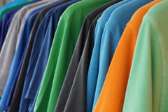 Multicolored polo shirts. Clothes rack with multicolored men's polo shirts Royalty Free Stock Photo