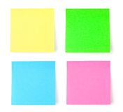 Multicolored postit note paper. Isolated on white background Stock Photography