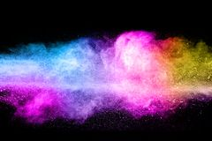 Multicolored powder explosion cloud isolated on black background. Freeze motion of color dust  particles splash Stock Photo
