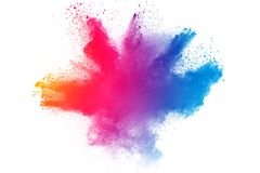 Multicolored powder explosion. Isolated on white background. Color dust splashing. Color particles splatter on white background Stock Images