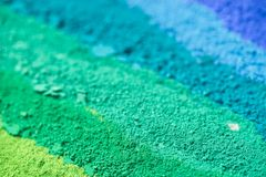 Multicolored powder pigments background. Selective focus Royalty Free Stock Photography
