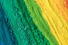 Multicolored powder pigments background. Selective focus Stock Image