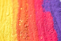Multicolored powder pigments background. Selective focus Royalty Free Stock Image