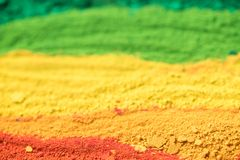 Multicolored powder pigments background. Selective focus Stock Photos