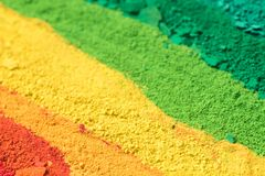 Multicolored powder pigments background. Selective focus Royalty Free Stock Images