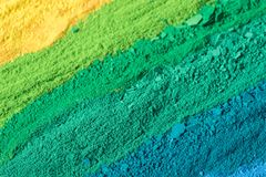 Multicolored powder pigments background. Selective focus Stock Photo
