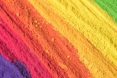 Multicolored powder pigments background. Selective focus Stock Images