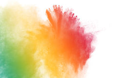 Multicolored powder splatted. Abstract multicolored powder splatted on white background,Freeze motion of color powder exploding Stock Images