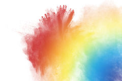 Multicolored powder splatted. Abstract multicolored powder splatted on white background,Freeze motion of color powder exploding Stock Photos