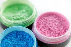 Multicolored professional powder eye-shadows on white background Stock Photo