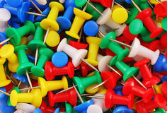 Multicolored push pins Stock Image