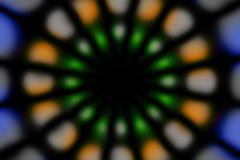 Multicolored radial circle dark pattern. Deep blue, green, orange, grey and black radial circle pattern stock photos