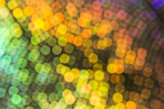 Multicolored rainbow blurred bokeh on dark background. N stock image