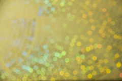 Multicolored rainbow blurred bokeh on dark background. N royalty free stock photography