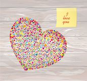 Multicolored rainbow confetti in the shape of a heart. Yellow sh. Eet of paper for notes. Sticker.Vector on wooden background. Love. Postcard or invitation for a Stock Photos