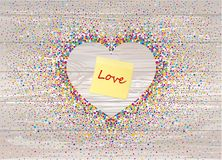 Multicolored rainbow confetti in the shape of a heart. Yellow sh. Eet of paper for notes. Sticker.Vector on wooden background. Love. Postcard or invitation for a Stock Images