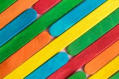 Multicolored rainbow wooden popsicle sticks abstract. Colorful popsicle sticks background abstract minimal creative concept stock photo
