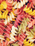 Multicolored Raw Spiral Pasta Stock Photos