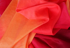 Multicolored red orange silk fabric Stock Images