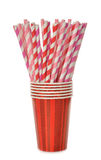 Multicolored retro straws in a paper cup Stock Images