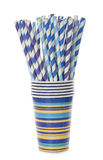 Multicolored retro straws in a paper cup Royalty Free Stock Images