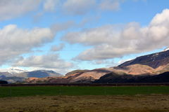 Multicolored rhyolite mountains and snow peaks in the area of the eastern fjords in Iceland Stock Photos